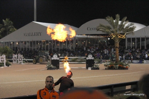 Fire eater entertains during interval.